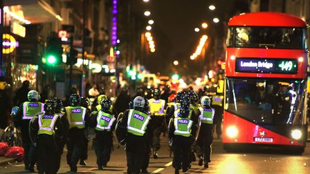 Riot police in Kingsland Road as a protest over the death of Rashan Charles saw tensions flare last