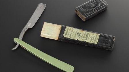 Cut throat razor in leatherette box, steel blade, pea green Parkesine handle made by Alexander Parke