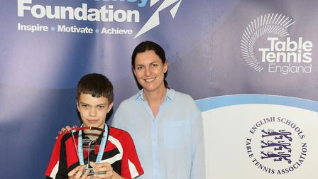 Alexandra Park School pupil Joseph Hunter faces the camera with Sara Sutcliffe, Table Tennis England