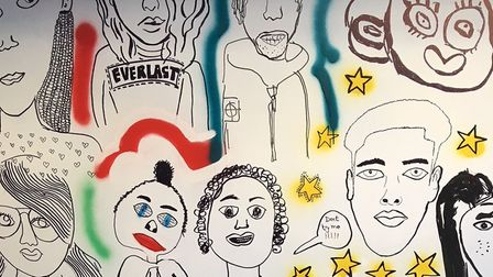 A mural at Hackney Quest's Poole Road HQ. It combines self-portraits of young people into a single a