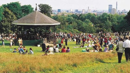 Families enjoying the sun at Parliament Hill bandstand. Picture: Heath Hands
