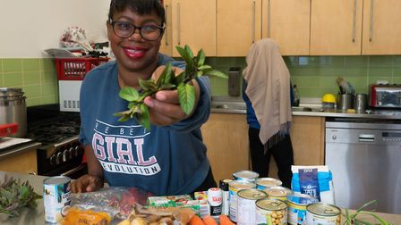 Nureen Glaves brandishes some herbs while explaining her menu. Picture: Siorna Ashby