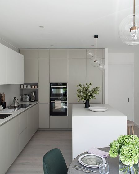 A niche under the corner unit, created to house the toaster and the espresso machine, reduces clutte