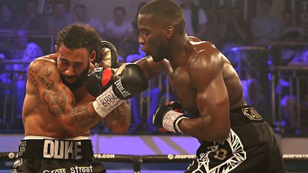 Lawrence Okolie hits out on his way to victory (pic Natalie Mayhew/Butterfly Boxing)