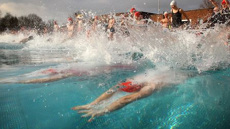 Participants dive in to the water at the Outdoor Swimming Society December Dip 2012 at Parliament Hi
