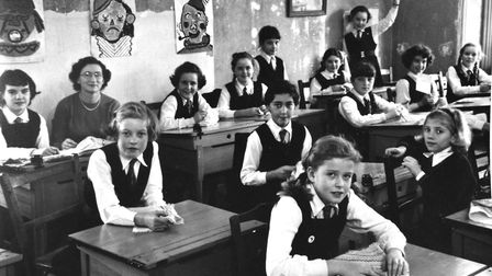 SHHS Junior branch classroom in 1957, featuring centre back sharing a desk, Joan Arnold and Linda Ca