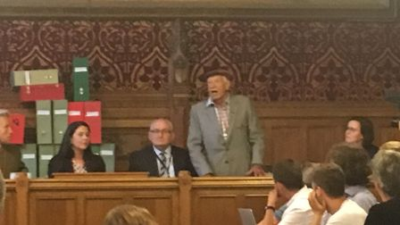 Ronnie Grant, 93, speaks at the meeting. He moved into his arches in 1960 and said Network Rail had