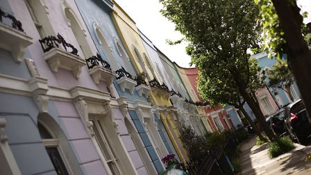 The colourfully painted houses of Kelly Street in Kentish Town. House prices in Camden are the third