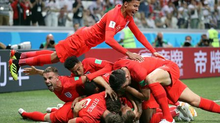 England's Harry Kane (hidden) is mobbed by team-mates after scoring against Tunisia (pic Owen Humphr