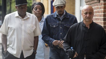 The family of Rashan Charles, including his father Esa (second right) arrive at Poplar Coroner's Cou