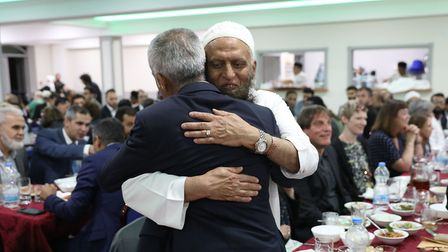 Eusoof Amerat, a trustee of the Masjid-e-Quba mosque, greets the Mayor of London at the community If