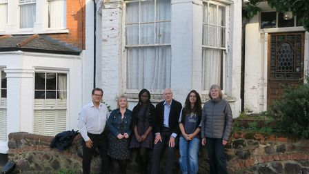 Cllr Julia Ogiehor with neighbours outside the house in Woodland Gardens, Muswell Hill. Picture: Har