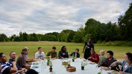 The group eat together after a day of foraging. Picture: Sanjay Bhattacharya for Root Camp