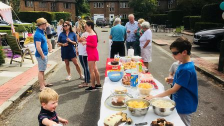Children and adults alike enjoy the street party on Grey Close in Hampstead Garden Suburb. Picture: