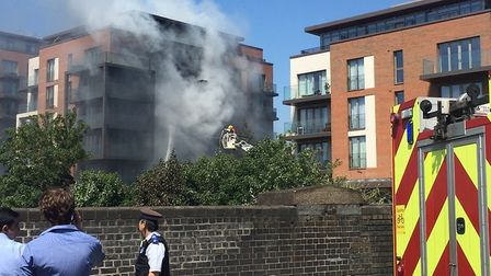 Firefighters putting out the blaze in West Hampstead on Tuesday morning. Picture: Lucas Cumiskey