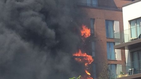The building on fire in West Hampstead. Picture: Lucas Cumiskey