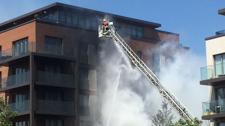 Firefighters tackling the blaze in the Orwell Building. Picture: Lucas Cumiskey
