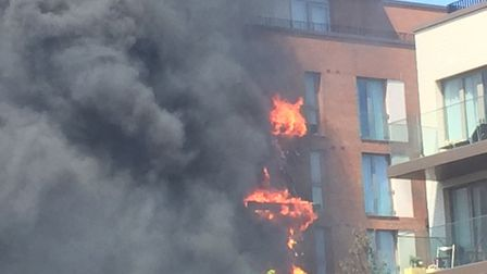 The balconies on fire. Picture: Lucas Cumiskey