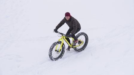 A lone cyclist on enjoying the snow in Beccles.Picture: Nick Butcher