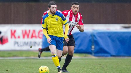 Michael O'Donohue of Haringey Borough brings the ball out of defence with Hornchurch's Nathan Cooper