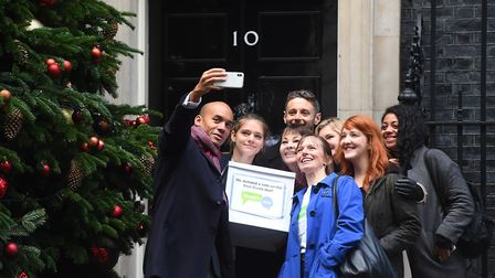 Caroline Lucas, Chuka Umunna and Justin Greening handing in a petition in support of a People's Vote