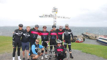 The Bums on Bikes team at John O'Groats with their backup team (From L to R), Tom Payne (backup team