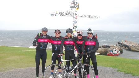 The Bums on Bikes team at John O'Groats (From L to R), Will Ridsdill Smith, Charles Mesquita, Doug T