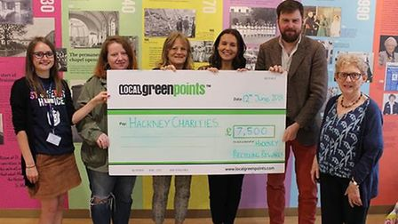 The cheque from donations is handed over to the charities. From L to R. Robyn Carlson (St Joseph's H