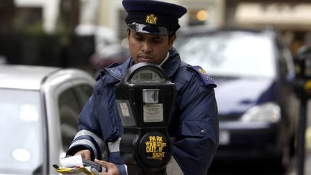A file image of a traffic warden. Picture: PA
