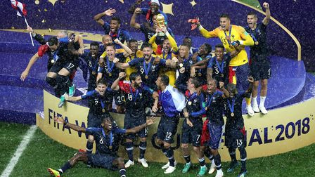 France celebrate with the trophy after winning the FIFA World Cup Final with captain Hugo Lloris lif