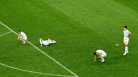 England's Jamie Vardy (left to right), Dele Alli, Harry Kane and Harry Maguire appear dejected after