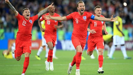 England's Harry Kane and team-mate Kieran Trippier (left) celebrate winning the penalty shoot-out ag
