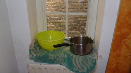 Saucepans were used to catch leaking water in the flats. Picture: Camden Council