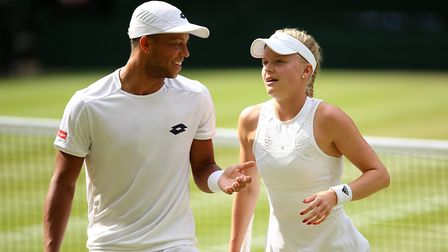 Jay Clarke and Harriet Dart during the mixed doubles on day ten of the Wimbledon Championships (pic