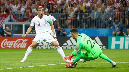 England's Harry Kane has an attempt on goal saved by Croatia goalkeeper Danijel Subasic during the W