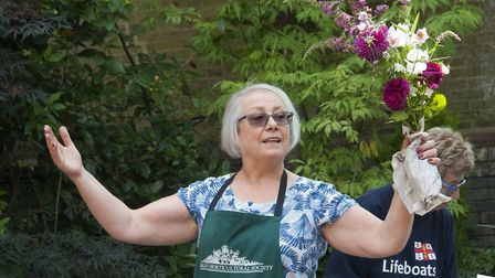 Roxan Stirling auctions exhibits at the end of the Highgate Horticultural Society's summer show. Pic