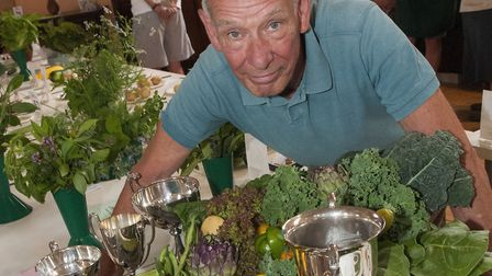 Gary Sycamore with his trophies and prize-winning veg at the Highgate Horticultural Society's summer