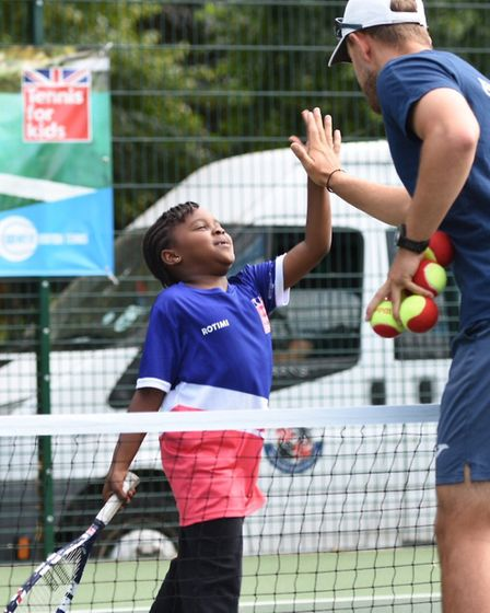 a local youngster enjoying an LTA Tennis for Kids session