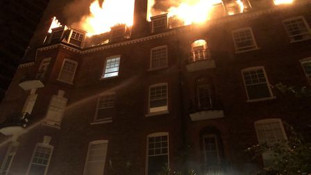 The block on fire in Inglewood Road, West Hampstead. Picture: @Matt4lis