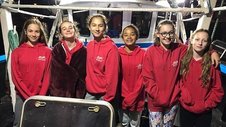 The girls aboard the Viking Princess boat at 4am before departure. From left to right: Lucy Sims, Ev