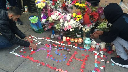 A vigil for Rashan outside the Yours Locally shop in Kingsland Road. Picture: Emma Bartholomew