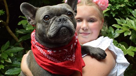Miss Hampstead contestant, Lola the French Bulldog, with owner Chloe Waters aged 10. Picture: Polly