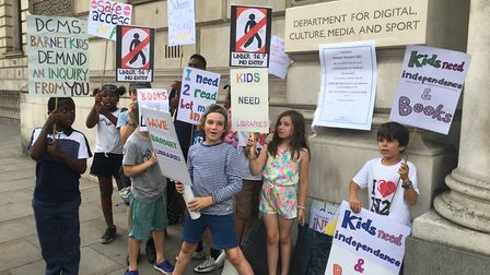 Teenagers taking part in the protest against cuts to library services outside the Department of Cult
