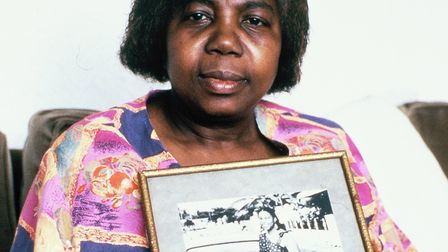 Myrna Simpson with a picture of her daughter Joy Gardner in 1993. Picture: Ken Fero / Migrant Media