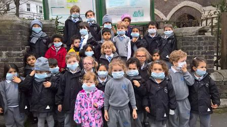 Schoolchildren in Hampstead wear face masks to protest against pollution. Picture: Jessica Learmond-