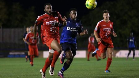 Arinse Uade of Harrow Borough and Reece Beckles-Richards of Wingate & Finchley battle for the ball (