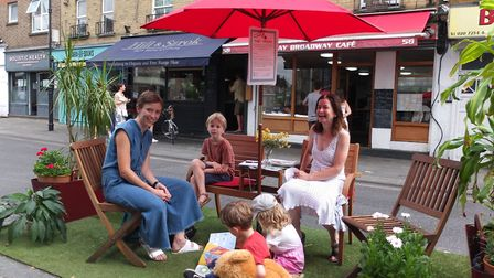 """Brenda Puech (right) welcoming visitors to her """"people's parking bay"""" - or """"parklet"""" as they are now"""