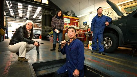 Inside the arch of Chu's Garage in Helmsley Place, the Chu family, from left Quang Chu, Nhi Chu, Cha