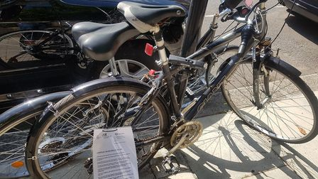 The peculiar laminated legal threats have been attached to apparently abandoned bikes.