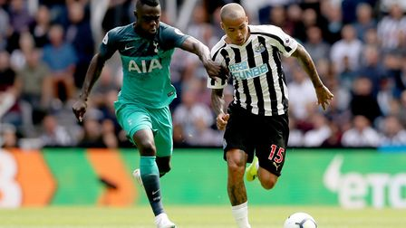 Newcastle United's Kenedy (right) and Tottenham Hotspur's Davinson Sanchez battle for the ball (pic:
